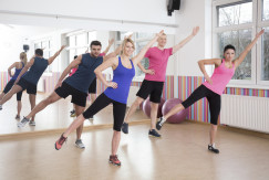 Four young people doing aerobics on fitness classes